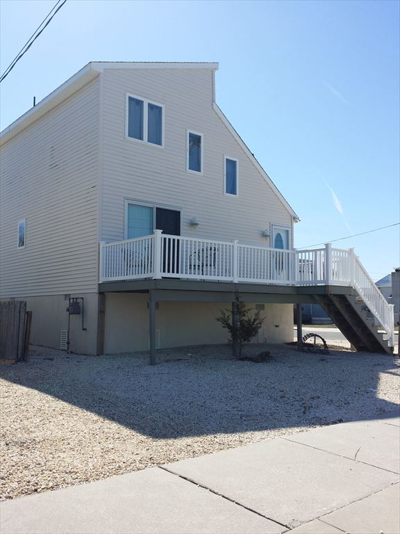 1411 DELAWARE AVENUE, NORTH WILDWOOD SEASONAL RENTAL - Three bedroom, two bath single family home with loft. Spacious property with a loft and 2 spacious exterior decks. Home has a fully equipped kitchen with range, fridge, disposal, dishwasher, microwave, toaster and coffeemaker. Amenities include central a/c, washer/dryer, wifi, outside shower, gas bbq, and 4 car off street parking.