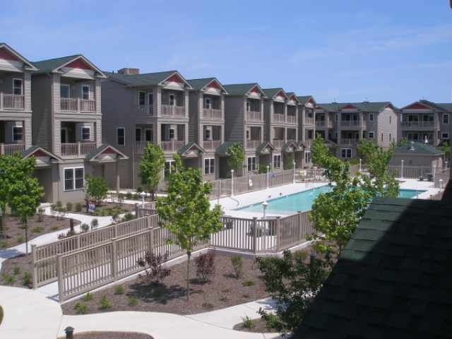 127 WEST SCHELLENGER AVENUE - WILDWOOD SQUARE CONDO RENTALS - 4 bedroom, 3 bath townhouse in Wildwood Square! Home offers a full kitchen with range, fridge, dishwasher, disposal, microwave, coffeemaker, toaster. Sleeps 11; 2 queen, 5 twin, full futon. Amenities include courtyard, pool, gas bbq, central a/c, washer/dryer, and 2 car garage parking. This townhouse provides plenty of space. First floor has queen bed and futon plus full bathroom. Also, has large 2 car garage. Second floor is a spacious open concept area featuring beautiful kitchen, dining room and living room with large front deck overlooking pool and courtyard. This floor also has a powder room and washer and dryer for your convenience. Third floor has 3 bedrooms and 2 full baths. Bedroom 1 sleeps 3 (1 single bed and trundle bed). 2nd bedroom sleeps 2 (2 single beds) and has a small deck that overlooks the Ferris Wheel and rides. Large Master Bedroom sleeps 2 (1 queen bed) plus own bathroom and has its own large deck overlooking the pool and courtyard. Wildwood Rentals, North Wildwood Rentals, Wildwood Crest Rentals and Diamond Beach Rentals in all price ranges for weekly, monthly, seasonal and weekend vacation rentals plus Wildwood real estate sales of homes, condos, vacation and investment properties in and around Wildwood New Jersey. We offer over 400 properties plus exclusive vacation homes so you can book the shore rental of your choice online and guarantee your vacation at the Shore. Rent with confidence at Island Realty Group!