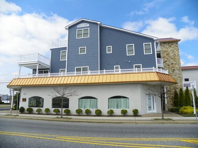 1810 NEW JERSEY AVENUE #303 - SUMMER RENTAL in NORTH WILDWOOD - Three bedroom, two bath vacation home located in North Wildwood. Complex offers a pool, hot tub, elevator, 2 car off street parking, outside shower, and gas bbq. Home has a full kitchen with range, fridge, icemaker, disposal, dishwasher, microwave, coffeemaker, blender, and toaster. Sleeps 8; king, queen, 2 twin and queen sleep sofa. Amenities include central a/c, washer/dryer, wifi, 2 balconies with a panoramic view!
