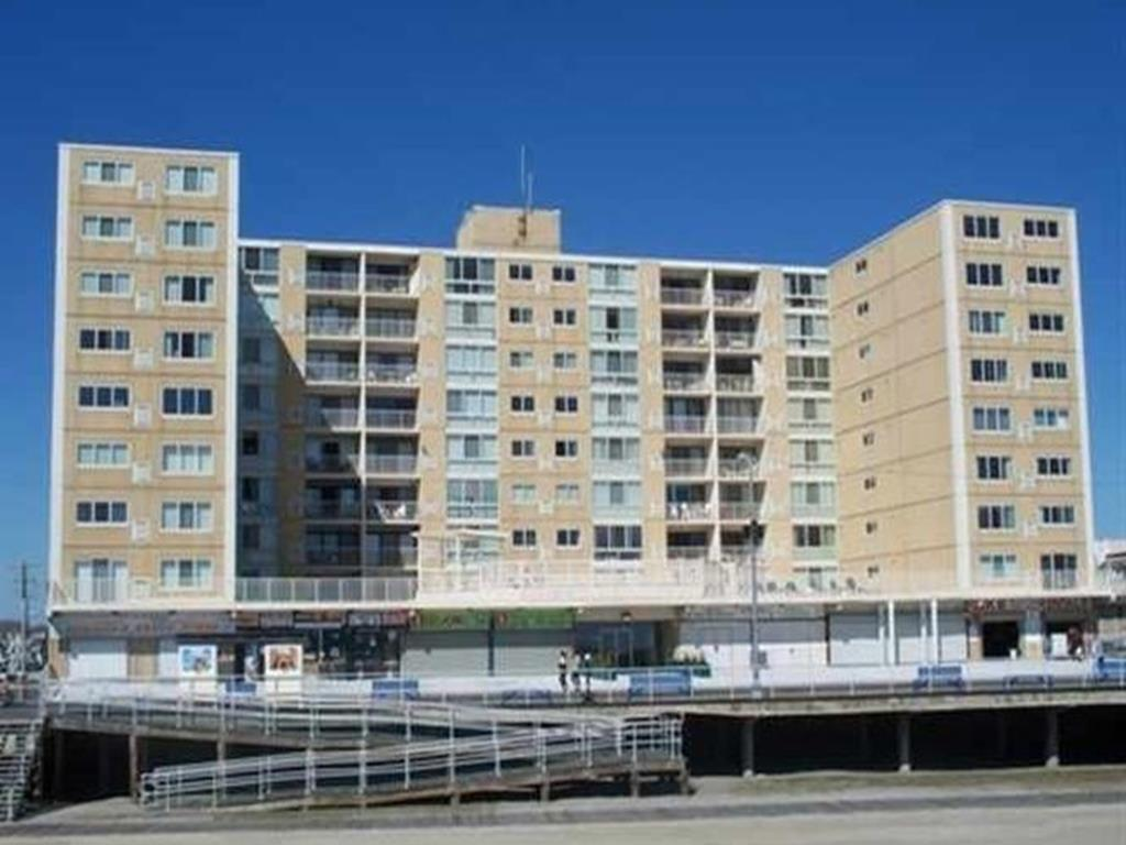 1900 BOARDWALK #101 - NORTH WILDWOOD BEACHFRONT SUMMER VACATION RENTALS with POOLS at WILDWOODRENTS.COM  - 2 Bedroom 2 Bath condo located Beachfront in North Wildwood with a pool and huge sundeck. Unit offers full kitchen, off-street parking for 1 and of course a spectacular location. Sleeps 8; 4 Single Beds, 1 Queen, 1 Double. North Wildwood Rentals, Wildwood Rentals, Wildwood Crest Rentals and Diamond Beach Rentals in all price ranges for weekly, monthly, seasonal and weekend vacation rentals plus Wildwood real estate sales of homes, condos, vacation and investment properties in and around Wildwood New Jersey. We offer over 400 properties plus exclusive vacation homes so you can book the shore rental of your choice online and guarantee your vacation at the Shore. Rent with confidence at Island Realty Group! Visit www.wildwoodrents.com to book online or call our office at 609.522.4999. Our office at 1701 New Jersey Avenue in North Wildwood is open 7 days a week!
