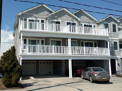 2506 SURF AVENUE – UNIT 100 – NORTH WILDWOOD SUMMER VACATION RENTALS WITH POOLS – Location, Pool and New Owner this Season will all add up to a great family vacation full of memories. Tastefully decorated in a Coastal them this 3 bedroom 2 bath condominium is conveniently located 50ft from Beachblock in North Wildwood. Larger  than your typical condo with well-proportioned bedrooms and an fully-appointed kitchen overlooking the expansive living room, you'll first notice the upgrades throughout this fine home. Granite counters and vanities, tumbled Travertine backsplashes, glistening floors and a full-width deck perfect for people watching. Each bedroom is uniquely decorated with the Master Bedrooms offering a private bath with double basins and a large walk-in closet. Both baths are outfitted with tubs and sliding doors. Additional amenities include Central HVAC, off-street parking for 2 (1 in Private garage and 1 in Driveway) private in-home laundry with full-sized washer and dryer, Hi-Speed Internet, outside shower and don't forget the inviting pool. All of this is located within steps to the World-Famous Wildwood Boardwalk, Beach, Morey's Piers and Sam's Pizza! Sleeps 9; Guest Bedroom 1: Queen, Guest Bedroom 2: Bunk with 1 Full and 1 Single, Master Bedroom: 1 Queen, 1 Queen Sofa Bed in Living Room. North Wildwood Rentals, Wildwood Rentals, Wildwood Crest Rentals and Diamond Beach Rentals in all price ranges for weekly, monthly, seasonal and weekend vacation rentals plus Wildwood real estate sales of homes, condos, vacation and investment properties in and around Wildwood New Jersey. We offer over 400 properties plus exclusive vacation homes so you can book the shore rental of your choice online and guarantee your vacation at the Shore. Rent with confidence at Island Realty Group! Visit www.wildwoodrents.com to book online or call our office at 609.522.4999. Our office at 1701 New Jersey Avenue in North Wildwood is open 7 days a week!