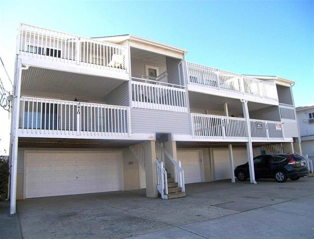 North Wildwood Rental at 408 E 16th Avenue #5 - Three bedrooms two bath vacation home located in North Wildwood. Home has a full kitchen with range, fridge, dishwasher, microwave, disposal, coffeemaker, blender and toaster. Sleeps 6; 2 queen, and 2 twins. Amenities include central a/c, washer/dryer, outside shower, WiFi, balcony, and 2 car off street parking. Park your car and enjoy the freedom the location has to offer. Walking distance to beach & boards. Close to restaurants, pub, indoor water park! Home boasts an ocean view! *Please be advised that owner has 2 beagles that periodically are in this home.