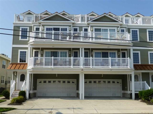 426 EAST 20TH AVENUE - #202 - SAN SOUCI CONDOMINIUM RENTALS WITH POOL IN NORTH WILDWOOD - 4 Bedroom 3 Bath upscale condo with multi-floor layout sleeps 10. Full kitchen and expansive decks plus a spectacular pool. 1 King, 2 Doubles, 2 Singles, 1 Queen Sleep Sofa, 1 Bunk.North Wildwood Rentals, Wildwood Rentals, Wildwood Crest Rentals and Diamond Beach Rentals in all price ranges for weekly, monthly, seasonal and weekend vacation rentals plus Wildwood real estate sales of homes, condos, vacation and investment properties in and around Wildwood New Jersey. We offer over 400 properties plus exclusive vacation homes so you can book the shore rental of your choice online and guarantee your vacation at the Shore. Rent with confidence at Island Realty Group!