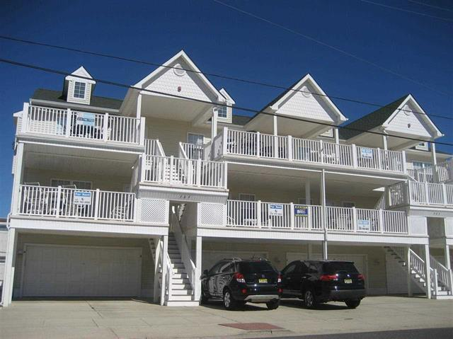 "505 EAST 13TH AVENUE UNIT B - NORTH WILDWOOD BEACHBLOCK SUMMER RENTAL - LOCATION, LOCATION, LOCATION! The number one rule in real estate is location and the same goes for your summer rental. Only steps to the beach in North Wildwood this ""stunner"" of a condo will take your breath away. Completely remodeled throughout with upscale furnishings, a gourmet kitchen and exquisite decorative elements this fine property is an entertainer s delight. Offering 3 bedrooms and 2 baths this unit comfortably sleep 8 and offers 2 full baths with tubs. Central HVAC, outdoor shower, off-street parking and an oceanview deck round out this wonderful summer home. Bedding includes 1 King, 2 single bunks and 2 singles. Did we mention the Location! Offered exclusively by Island Realty Group, North Wildwood Realtors"